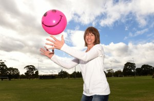 Laughter yoga facillitator Ros Ben-Moshe, who is the director of LaughLife Wellbeing Programs, with a laughter ball at a park in Caulfield North.